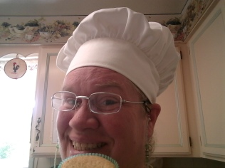 First cupcake..love the baker's hat?